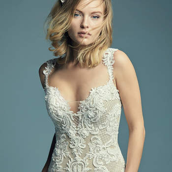 """<a href=""""https://www.maggiesottero.com/maggie-sottero/abbie/11450"""">Maggie Sottero</a>  This elegant fit-and-flare wedding dress features embroidered lace motifs and crosshatching over tulle. Chic lace straps glide from the illusion plunging sweetheart neckline to the illusion scoop back, all accented in beaded lace motifs. Lined with shapewear for a figure-flattering fit. Finished with covered buttons over zipper closure."""