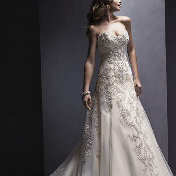 """Return to romance in this Marquice organza A-line wedding gown with glimmering lace appliqués. Complete with strapless, sweetheart neckline and finished with covered button over zipper and inner corset closure.   <a href=""""http://www.sotteroandmidgley.com/dress.aspx?style=5SR133"""" target=""""_blank"""">Sottero and Midgley Spring 2015</a>"""