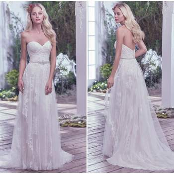 """Understated elegance is found in this romantic sheath wedding dress featuring layers of tulle, adorned with Swarovski crystals, pearls, and lace appliqués. A glimmering beaded belt and sweetheart neckline, add touches of refined femininity. Finished with covered buttons over zipper closure.   <a href=""""https://www.maggiesottero.com/maggie-sottero/bailey/9738"""" target=""""_blank"""">Maggie Sottero</a>"""