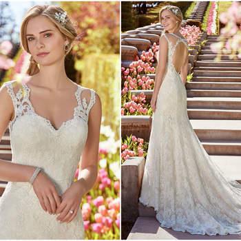 Ein runder Rückenausschnitt mit Illusions-Ärmeln und langer Schleppe passen bestens zu diesem romantischen Brautkleid.