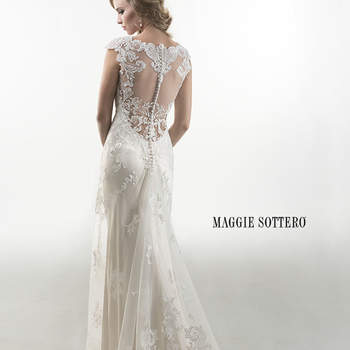 "Sheath gown featuring bold floral embroidered overlay, accented with sparkling Swarovski crystals. Finished with illusion lace back adorned with crystal button closure and separate satin slip dress. Offered with Monroe slip dress or slip dress with raised back.  <a href=""http://www.maggiesottero.com/dress.aspx?style=4MS997"" target=""_blank"">Maggie Sottero Platinum 2015</a>"