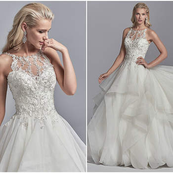 "Shimmering lace motifs accented with beading and Swarovski crystals cascade over the bodice of this ballgown wedding dress, completing the illusion halter over sweetheart neckline and scoop back. Complete with tiered tulle skirt trimmed in horsehair. Finished with crystal buttons over zipper closure.  <a href=""https://www.maggiesottero.com/sottero-and-midgley/murphy/11219?utm_source=zankyou&amp;utm_medium=gowngallery"" target=""_blank"">Sottero and Midgley</a>"
