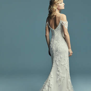 """<a href=""""https://www.maggiesottero.com/maggie-sottero/angelica/1144"""">Maggie Sottero</a>  Soft and elegant, this sheath wedding dress features cascading lace motifs over tulle. Illusion cold-shoulder sleeves and beaded spaghetti straps complete the sweetheart neckline and scoop back for a romantic feel. Finished with covered buttons over zipper and inner elastic closure"""