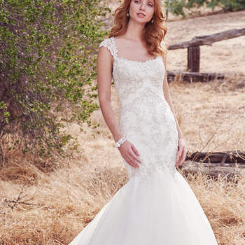 Schimmernde Perlen, die bei diesem Brautkleid im Meerjungfrauen-Stil für ganz besondere Highlights sorgen.