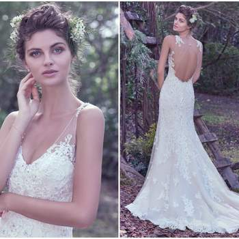 """Subtle romance and elegance is found in this ethereal sheath wedding dress made of tulle and bead embellished lace sparkling with Swarovski crystals. Lace details embellish illusion shoulders, a plunging V-neckline, and open illusion lace back. Finished with crystal buttons over zipper closure.   <a href=""""https://www.maggiesottero.com/maggie-sottero/wynter/9698"""" target=""""_blank"""">Maggie Sottero</a>"""