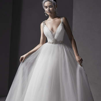 """Modern romance is found in this sophisticated tulle ballgown. Decadent Swarovski crystals adorn the shoulders and dramatic back, while a plunging neckline is accented with illusion tulle. Finished with crystal button over zipper closure.  <a href=""""http://www.sotteroandmidgley.com/dress.aspx?style=5SS123"""" target=""""_blank"""">Sottero and Midgley Spring 2015</a>"""