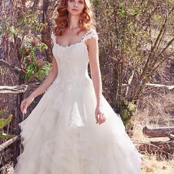 Mit diesem romantischen Brautkleid werden Sie sicherlich den schönsten Tag in Ihrem Leben haben! Wer wünscht sich nicht einen so rüschig-schönen Rock als Highlight bei der Hochzeit?