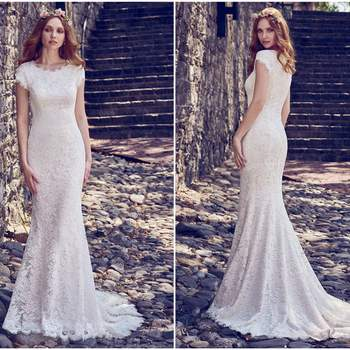 """Allover lace comprises this romantic fit-and-flare wedding dress, featuring a jewel neckline and cap-sleeves. Lined with Inessa Jersey for a luxe fit. Finished with zipper closure. Detachable Fallow Organza overskirt with Swarovski crystal waistband sold separately.  <a href=""""https://www.maggiesottero.com/maggie-sottero/raylene/11188?utm_source=zankyou&amp;utm_medium=gowngallery"""" target=""""_blank"""">Maggie Sottero</a>"""