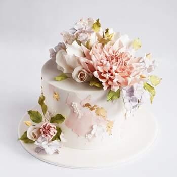 Foto: Cake Ink - Pastel de fondant recargado de adornos