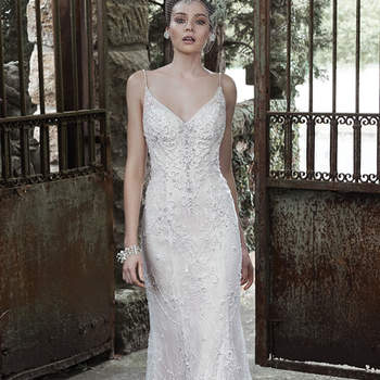 "Glamorous Swarovski crystals, shimmering pearls and sparkling sequins drift down the tulle and lace skirt of this sheath wedding dress, accented with V-neckline and dainty, pearl encrusted spaghetti straps. Finished with plunging scoop back and pearl buttons over zipper closure.   <a href=""http://www.maggiesottero.com/dress.aspx?style=5MT654"" target=""_blank"">Maggie Sottero</a>"