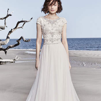"Beaded embroidery and Swarovski crystals dance over the bodice of this A-line, completing the illusion jewel neckline and cap-sleeves. A chic skirt of tulle completes this modest vintage-inspired wedding gown. Finished with zipper closure.  <a href=""https://www.maggiesottero.com/sottero-and-midgley/ezra-rose/11534"">Sottero and Midgley</a>"