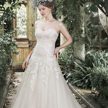 "Timeless lace and soft tulle combine to create this elegant A-line wedding dress with dropped waist and romantic sweetheart neckline. Finished with crystal buttons over zipper and inner corset closure.  <a href=""http://www.maggiesottero.com/dress.aspx?style=5MB681"" target=""_blank"">Maggie Sottero</a>"