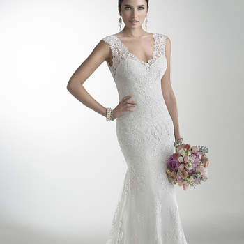 """Delicate corded lace on tulle skims the shoulders and neckline of this lightweight gown while buttons trail a zipper closure accenting an illusion back. Offered with Monroe slip dress or slip dress with raised back, and in a long-sleeve version. <a href=""""http://www.maggiesottero.com/dress.aspx?style=4MS061"""" target=""""_blank"""">Maggie Sottero</a>"""