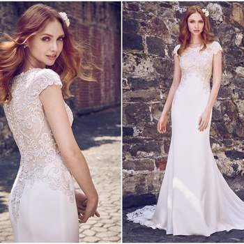"This glamorous sheath wedding dress features an elegant Aldora Crepe skirt and a striking cut-out train comprised of illusion lace appliqués. Shimmering beading and embroidered lace motifs swirl along the bodice's jewel neckline, cap-sleeves, and back. Finished with crystal buttons over zipper closure.  <a href=""https://www.maggiesottero.com/maggie-sottero/odette-marie/11181?utm_source=zankyou&amp;utm_medium=gowngallery"" target=""_blank"">Maggie Sottero</a>"