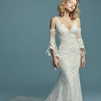 """<a href=""""https://www.maggiesottero.com/maggie-sottero/lucienne-marie/11278"""">Maggie Sottero</a>  Embroidered lace motifs waltz over dotted tulle in this boho sheath wedding dress, completing the illusion sweetheart neckline and illusion scoop back. Featuring a breathtaking illusion double-train accented in lace motifs, and lined with Cypress Jersey for a luxe fit. Finished with covered buttons over zipper closure. Detachable illusion poet sleeves accented in lace motifs sold separately."""