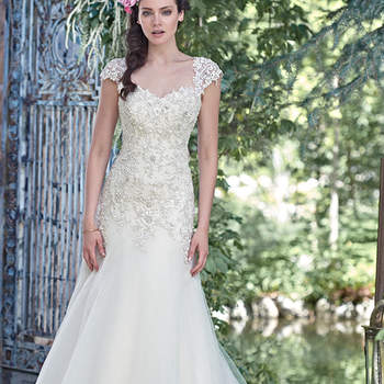 """Elegant and sophisticated, this A-line wedding dress combines a decadent, Swarovski crystal beaded lace bodice with an ethereal Chic organza and tulle skirt, perfect for the truly romantic bride. Finished with sweetheart neckline and corset closure. Detachable beaded lace cap-sleeves sold separately. <a href=""""www.maggiesottero.com/maggie-sottero/ladonna/9495"""" target=""""_blank"""">Maggie Sottero/a&gt;"""