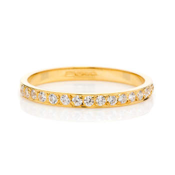 Cherish Eternity - The beautiful golden band of channel-set diamonds creates a dazzling display of devotion on your finger. Thirty sparkling diamonds cover the surface of the ring making it shine and shimmer from every angle.