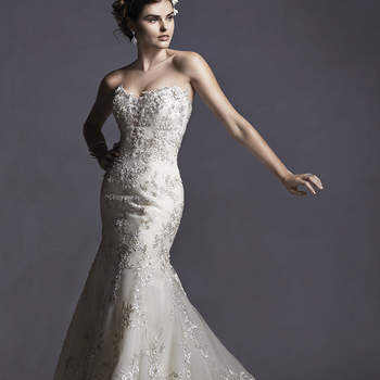 """Glimmering lace appliqués trail a soft tulle skirt in this fit and flare wedding dress. Floral lace appliqués trace the hem and adorn a plunging illusion sweetheart neckline. Finished with crystal button and zipper over inner elastic closure. Also available with corset back closure.   <a href=""""http://www.sotteroandmidgley.com/dress.aspx?style=5SR049LU"""" target=""""_blank"""">Sottero and Midgley Spring 2015</a>"""