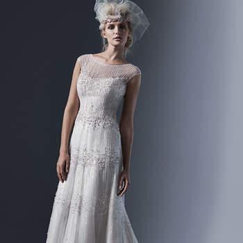 """Les lignes délicates de perles et de paillettes opalescentes tracent la longueur de cette robe de mariée en fourreau de tulle. La séduction est de mise grâce à une encolure illusion et des perles cousues à la main et des boutons en nacre.     <a href=""""http://www.sotteroandmidgley.com/dress.aspx?style=5ST608"""" target=""""_blank"""">Sottero &amp; Midgley</a>"""