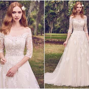 """Romantic lace motifs cascade over tulle in this illusion, off-the-shoulder, A-line wedding dress. Lace motifs complete the illusion portrait neckline, illusion half-sleeves, and illusion back. Finished with covered buttons over zipper closure.   <a href=""""https://www.maggiesottero.com/maggie-sottero/bree/11160?utm_source=zankyou&amp;utm_medium=gowngallery"""" target=""""_blank"""">Maggie Sottero</a>"""