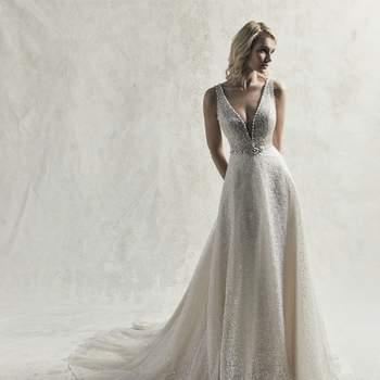 Este vestido de novia de estilo vintage destaca por sus capas de tul y detalles de lentejuelas.