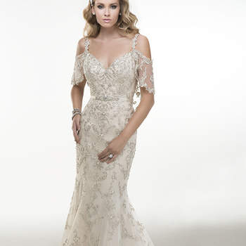 "Illusion cold shoulder flutter sleeves adorn this dazzling Swarovski crystal embroidered tulle A-line gown finished with crystal buttons and zipper over inner elastic back closure. Includes detachable grosgrain ribbon belt with Swarovski crystal embellishment.  <a href=""http://www.maggiesottero.com/dress.aspx?style=4MS959"" target=""_blank"">Maggie Sottero Platinum 2015</a>"