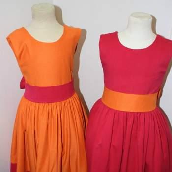 Ravissantes robes fuchsia et orange pour petite fille d'honneur.