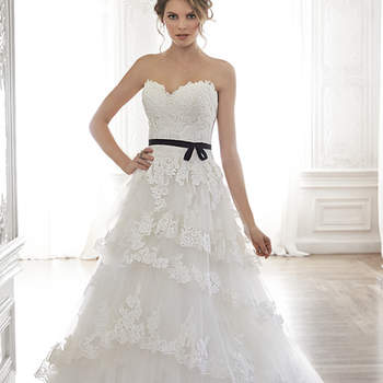 """Sweet and feminine is this gorgeous tulle and lace ball gown, complete with a romantic sweetheart neckline. Layers of lace-lined tulle drift down a voluminous skirt. Finished with covered button over zipper closure and inner corset. <a href=""""https://www.maggiesottero.com/maggie-sottero/bettina/8282"""" target=""""_blank"""">Maggie Sottero</a>"""