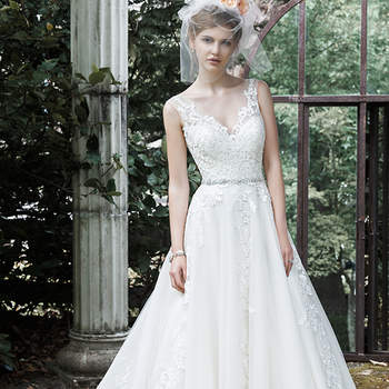 """This exquisite ball gown wedding dress is complete with floral lace appliqués drifting down a tulle skirt, an elegant illusion V-neckline, and a glittering Swarovski crystal belt. Finished with plunging V-back and crystal buttons over zipper closure. <a href=""""http://www.maggiesottero.com/dress.aspx?style=5MS701"""" target=""""_blank"""">Maggie Sottero</a>"""