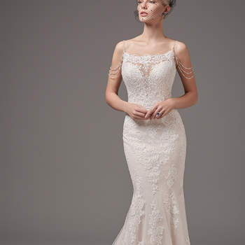 "Alluring and vintage-inspired, this lace fit-and-flare features an illusion square over plunging neckline, an open back trimmed in sheer lace, and beaded straps and shoulder treatment. Finished with covered buttons over zipper closure.  <a href=""https://www.maggiesottero.com/sottero-and-midgley/rhett/10251?utm_source=mywedding.com&utm_campaign=spring17&utm_medium=gallery"" target=""_blank"">Sottero and Midgley</a>"