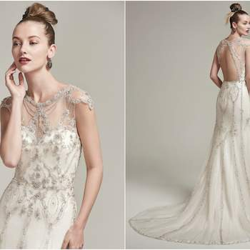 "Eye-catching beading adorns the sleek silhouette of this tulle sheath wedding dress, featuring an artistically embellished illusion neckline and cap-sleeves. Complete with stunning beaded illusion keyhole back. Finished with crystal buttons over zipper closure.   <a href=""https://www.maggiesottero.com/sottero-and-midgley/syanne/9884"" target=""_blank"">Sottero &amp; Midgley</a>"