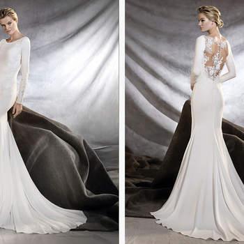 Elegantes Hochzeitskleid mit Boot-Ausschnitt und langen Ärmeln, das die weibliche Silhouette in den Vordergrund stellt.