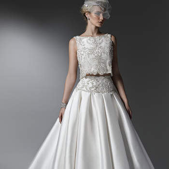 Luxurious and utterly breathtaking, this two-piece ball gown wedding dress is the epitome of glamour with a voluminous Vizela Mikado skirt with side seam pockets and a cropped, bead encrusted, lace top with Swarovski crystals. Finished with bateau neckline and zipper closure. <img height='0' width='0' alt='' src='http://ads.zankyou.com/mn8v' />