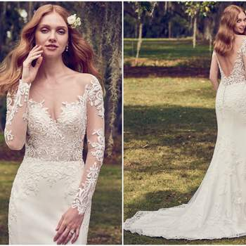 "This Yolivia Crepe fit-and-flare features an illusion nude bodice, illusion portrait neckline, and illusion long sleeves, all embellished in beaded lace motifs. An illusion V-back accented in lace motifs complete this sleeved wedding dress. Finished with covered buttons over zipper closure.  <a href=""https://www.maggiesottero.com/maggie-sottero/toccara/11196?utm_source=zankyou&amp;utm_medium=gowngallery"" target=""_blank"">Maggie Sottero</a>"