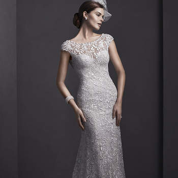 """Elaborate lace adorns this sheath wedding gown, with sparkling Swarovski crystals and pearls adorning a bateau neckline. Finished with dainty cap-sleeves and pearl button over zipper closure.  <a href=""""http://www.sotteroandmidgley.com/dress.aspx?style=5SR065"""" target=""""_blank"""">Sottero and Midgley Spring 2015</a>"""
