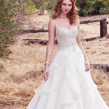 Sommerlich geht es bei diesem Brautkleid zu: Hier treffen Spaghetti-Träger auf einen voluminösen Rock und tolle Swarvoski-Kristalle.