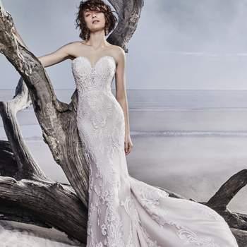 """<a href=""""https://www.maggiesottero.com/sottero-and-midgley/memphis/11557"""">Maggie Sottero</a> <br> Cette robe de mariée en tulle à la coupe ajustée est ornée de motifs en dentelle élégants rehaussés de fines perles et de paillettes."""