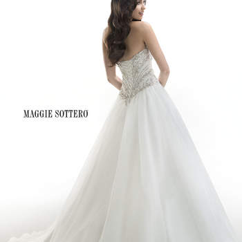 "Fairytale ballgown of Chic organza, accented with dazzling Swarovski crystals and beaded embroidery ornamenting the bodice. Corset back closure cinches the waist.   <a href=""http://www.maggiesottero.com/dress.aspx?style=4MT028"" target=""_blank"">Maggie Sottero Platinum 2015</a>"