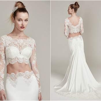 "An illusion lace crop top is accented with a stunning scalloped lace bateau neckline and long sleeves. The matching Belize satin sheath skirt with lace trim creates a fashion-forward two-piece wedding dress style.   Complete with a detailed illusion lace trimmed train and ruching. Finished with covered buttons and zipper closure.   <a href=""https://www.maggiesottero.com/sottero-and-midgley/fiona/9853"" target=""_blank"">Sottero &amp; Midgley</a>"