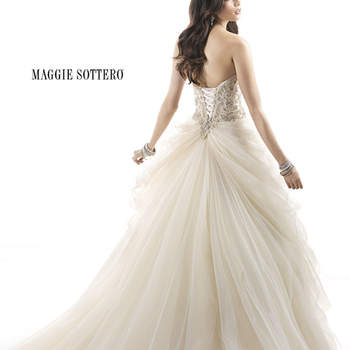 "Discover an update to the classic tulle ballgown in this romantic dress. Beaded tulle featuring Swarovski crystals wraps around the bodice before flowing into a gathered tulle skirt, completing the perfect look for the modern fairytale. Finished with corset back closure.  <a href=""http://www.maggiesottero.com/dress.aspx?style=4MW851"" target=""_blank"">Maggie Sottero Platinum 2015</a>"