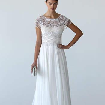 Robe de mariée blanche Marchesa Automne 2012. Décolleté en dentelle de toute beauté et coupe fluide font de cette robe une pure merveille. Source : Marchesa