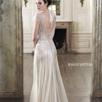 "The perfect blend of romance and refined sophistication is found in this tulle and Vogue satin sheath dress, complete with delicate tulle overlay, adorned with sparkling Swarovski crystals and pearl beads. Finished with ethereal tulle sleeves and covered button over zipper closure.  <a href=""http://www.maggiesottero.com/dress.aspx?style=5MN084"" target=""_blank"">Maggie Sottero Spring 2015</a>"
