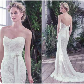 """Modern floral Guipure lace adds an updated touch to this vintage-inspired sheath wedding dress, with scoop neckline and scalloped hem. Finished with corset closure or crystal buttons over zipper and inner elastic closure. Brooch and grosgrain ribbon sold separately.   <a href=""""https://www.maggiesottero.com/maggie-sottero/lottie/9744"""" target=""""_blank"""">Maggie Sottero</a>"""