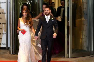 Argentine soccer player Lionel Messi and his wife Antonela Roccuzzo make an appearance for the press at their wedding in Rosario, Argentina, June 30, 2017. REUTERS/Marcos BrindicciCODE: X90087