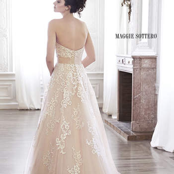 "Floral lace adorns the bodice and drifts down the tulle skirt of this A-line wedding dress, complete with soft scoop neckline and optional grosgrain ribbon belt, accented with dazzling Swarovski crystal brooch. Finished with corset closure or covered button over zipper and inner corset closure.   <a href=""http://www.maggiesottero.com/dress.aspx?style=5MT130LU"" target=""_blank"">Maggie Sottero Spring 2015</a>"
