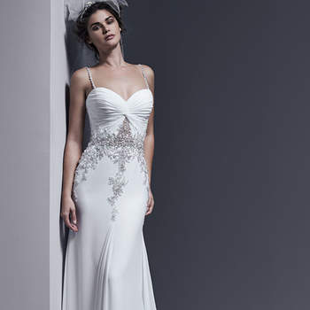 "Elegant Paris chiffon creates this streamlined sheath wedding dress, adorned with dramatic Swarovski crystal embellishments, pearls, and a seductive illusion cut-out at the waist. Crystal encrusted spaghetti straps accent the shoulders. Finished with crystal buttons over zipper and inner corset closure.   <a href=""http://www.sotteroandmidgley.com/dress.aspx?style=5SW686"" target=""_blank"">Sottero &amp; Midgley</a>"