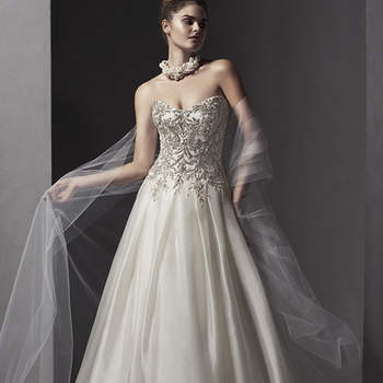"""Swarovski crystals and beads adorn the bodice of this luxurious ballgown, constructed of shimmering Chic organza. Complete with subtle scoop neckline. Finished with corset back closure.   <a href=""""http://www.sotteroandmidgley.com/dress.aspx?style=5SR042"""" target=""""_blank"""">Sottero and Midgley Spring 2015</a>"""
