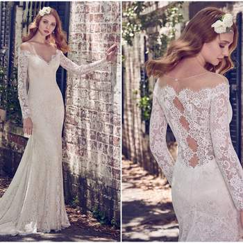"""Sheer lace comprises the illusion off-the-shoulder neckline and illusion long sleeves in this elegant lace wedding gown. A sheer lace back features a cascade of keyholes and a soft godet in the fit-and-flare skirt, while pearls cascade lightly down the front. Finished with pearl buttons and zipper closure.   <a href=""""https://www.maggiesottero.com/maggie-sottero/megan/11178?utm_source=zankyou&amp;utm_medium=gowngallery"""" target=""""_blank"""">Maggie Sottero</a>"""