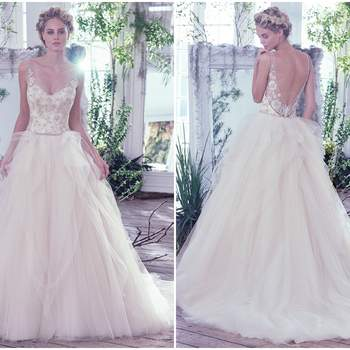 "This whimsical ball gown features embroidered lace, eye-catching Swarovski crystals, and beading intricately woven onto the fitted bodice with illusion sweetheart neckline and straps. Layers of tulle cascade weightlessly from the natural waistline creating an ultra-dreamy look. A dramatic illusion V-back is finished with crystal buttons over zipper closure.   <a href=""https://www.maggiesottero.com/maggie-sottero/carlotta/9727"" target=""_blank"">Maggie Sottero</a>"