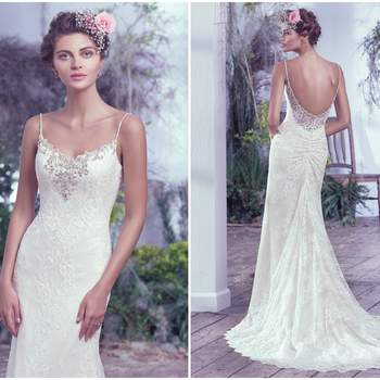 """Understated elegance is found in this allover lace sheath wedding dress. Delicate beaded spaghetti straps and sweetheart neckline embellished with pewter embroidery, Swarovski crystals, pearls and beads add a sophisticated twist to this classic silhouette. Complete with a low scoop illusion lace back. Finished with crystal buttons over zipper closure.   <a href=""""https://www.maggiesottero.com/maggie-sottero/kaari/9717"""" target=""""_blank"""">Maggie Sottero</a>"""